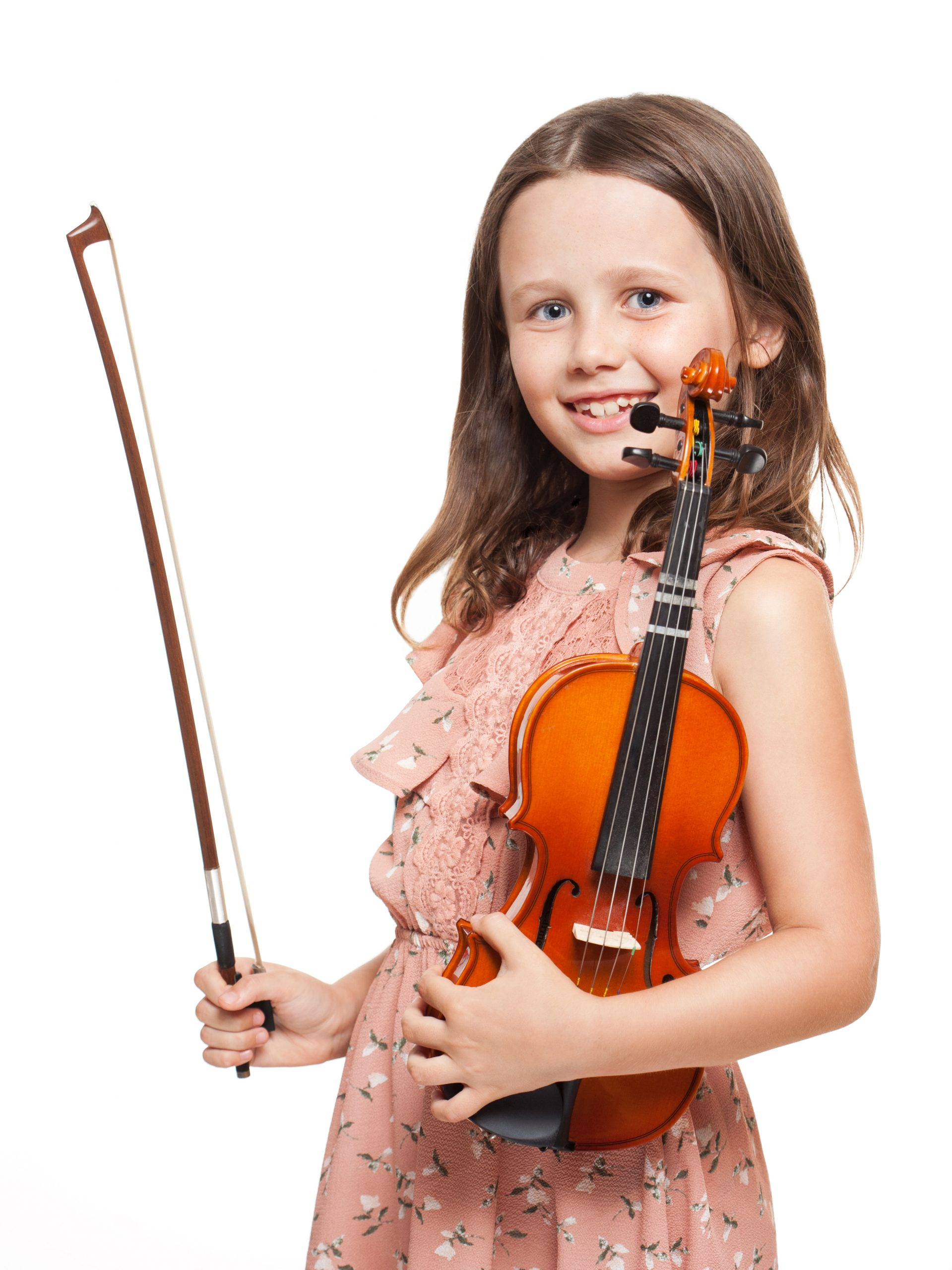 Portrait of a cute brunette girl playing violin.